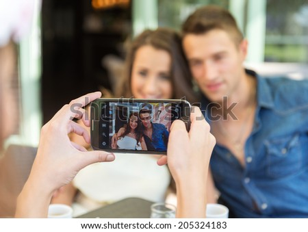 Smiling friends taking selfie photo