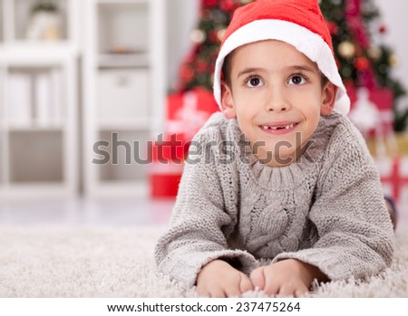 Smiling funny child in Santa red hat  Christmas concept.  - stock photo