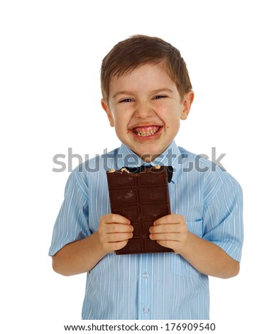 Smiling  funny young kid eating chocolate.White isolated - stock photo