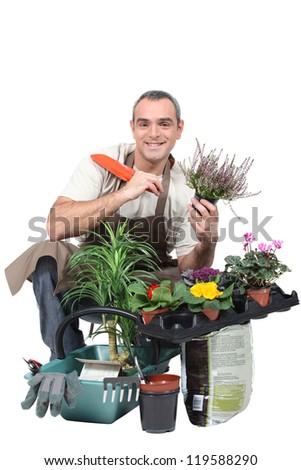 Smiling gardener on white background - stock photo