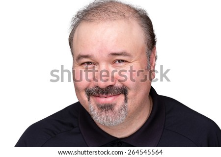 Smiling genial middle-aged man with a jovial expression beaming at the camera, head and shoulders isolated on white - stock photo