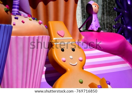 Smiling Gingerbread Man with Colorful Cupcake and Santa Claus Helper - Christmas fiberglass Mascots