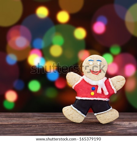 Smiling gingerbread men on a colored background - stock photo
