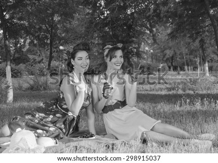 Smiling girl at a picnic waving retro