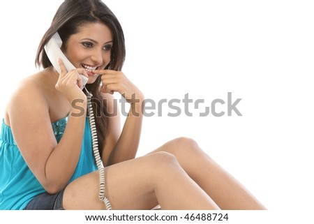 Smiling girl chatting in the phone - stock photo