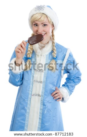 smiling girl dressed in traditional russian christmas costume of Snegurochka (Snow Maiden) eating ice cream, isolated on white background - stock photo