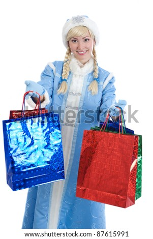 smiling girl dressed in traditional russian christmas costume of Snegurochka (Snow Maiden) with  a lot of bright gift packets, isolated on white background