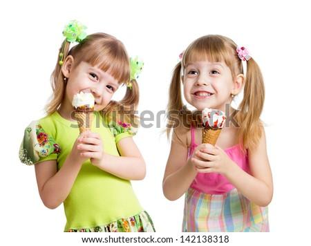 smiling girl eating ice cream in studio isolated - stock photo