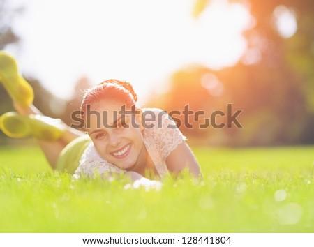 Smiling girl enjoying spring - stock photo