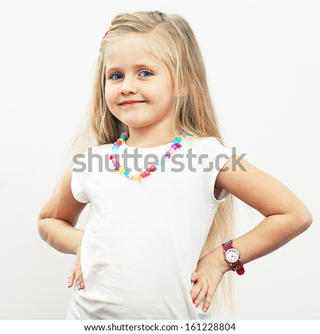 Smiling girl fashion portrait. Child model.