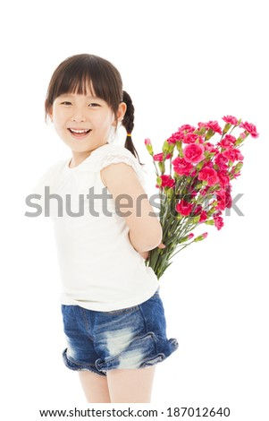 Smiling girl hiding a bouquet of carnations