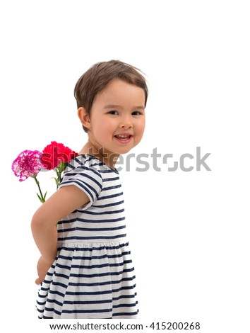Smiling girl hiding a bouquet of red carnations behind itself, i