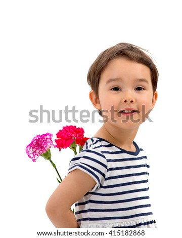 Smiling girl hiding a bouquet of red carnations behind itself,  isolated on white