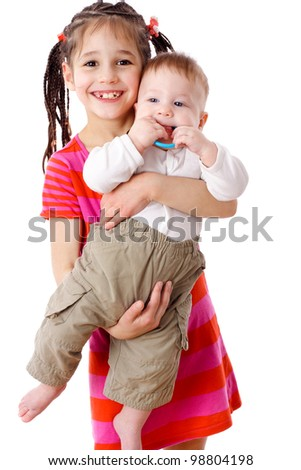Smiling girl holding a baby, isolated on white - stock photo