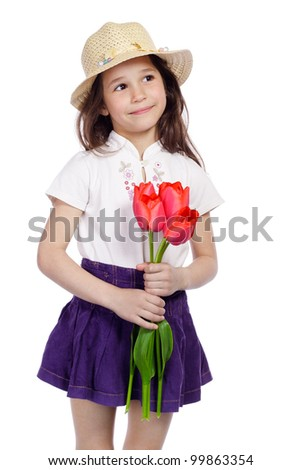 Smiling girl holding a bouquet of red tulips, isolated on white