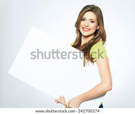 smiling girl holding blank sign board. studio portrait of young woman with sign card. isolated. - stock photo