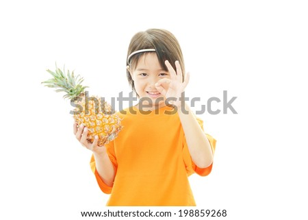 Smiling girl holding fruit - stock photo
