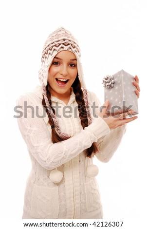 Smiling girl holding present on white background - stock photo