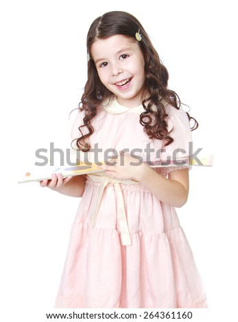 Smiling girl in a pink dress with a toy balalaika  - isolated on white background - stock photo