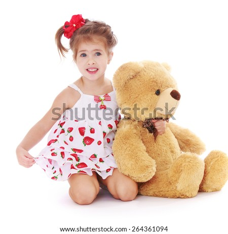 Smiling girl in a summer dress with Teddy bear  - isolated on white background - stock photo