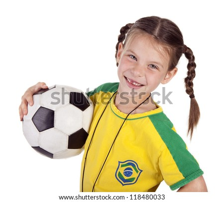 smiling girl in brazilian flag uniform with soccer ball