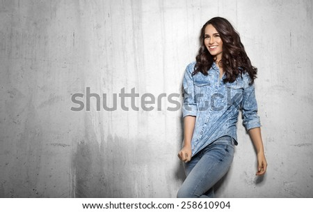 Smiling girl in denim with curly hair - stock photo