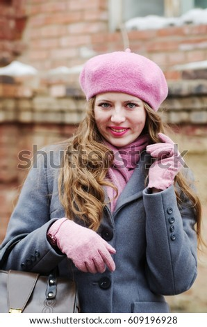 Smiling girl in gray coat and pink beret / The picture was taken in Russia, in the city of Orenburg, on Kobozev Street.