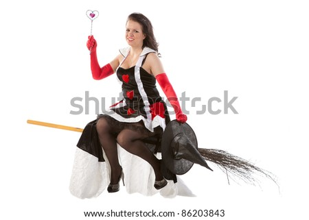 smiling girl in Halloween witch flying on a broom - stock photo