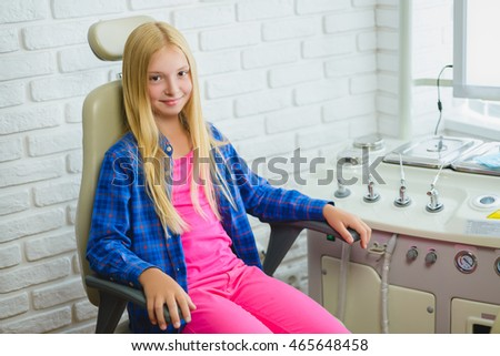 Smiling girl in Otolaryngologist cabinet at clinic