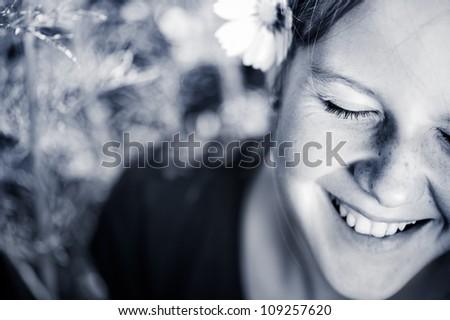 Smiling girl in park, portrait. - stock photo