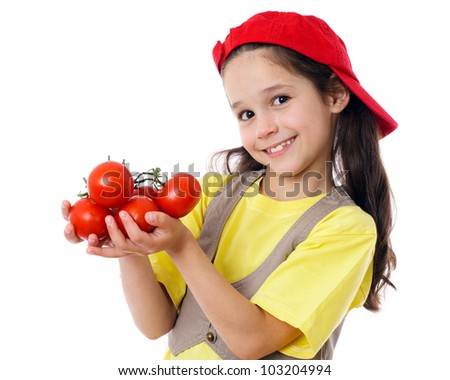 Smiling girl in red hat with tomatoes, isolated on white - stock photo