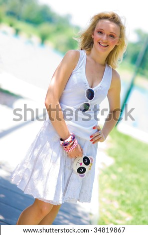 smiling girl in summer dress with cool wallet - stock photo