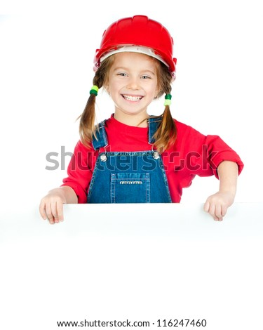 smiling girl in the construction helmet with a white board - stock photo