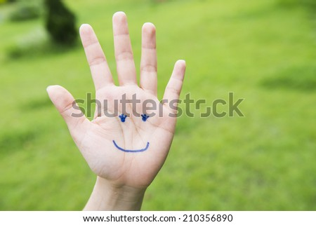 Smiling girl in the hand painted patterns - stock photo