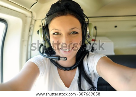 Smiling girl in the helicopter. - stock photo