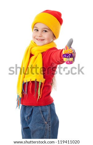 Smiling girl in winter clothes and thumb up sign, isolated on white - stock photo