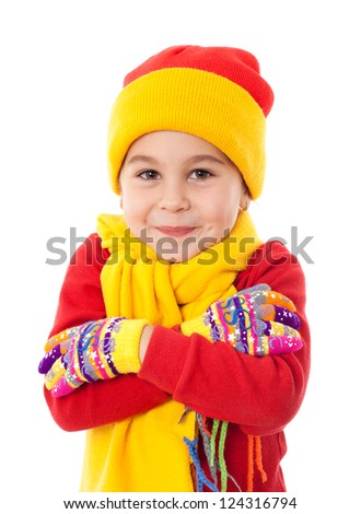 Smiling girl in winter clothes who is cold, isolated on white - stock photo