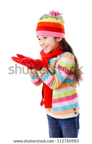 Smiling girl in winter clothes with empty hands, isolated on white