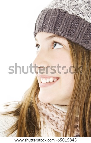 Smiling girl in winter style, looking up. - stock photo