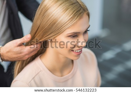 Smiling girl is sitting at the salon