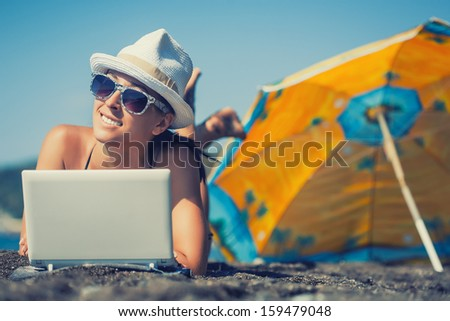 smiling girl is sunbathing on a beach