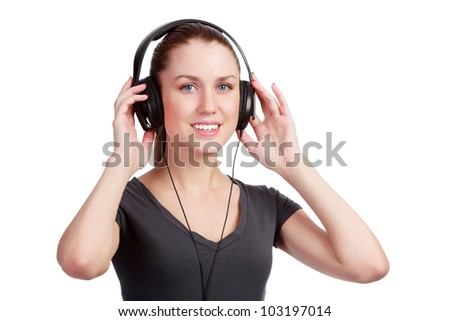 Smiling girl listening to music in headphones - stock photo