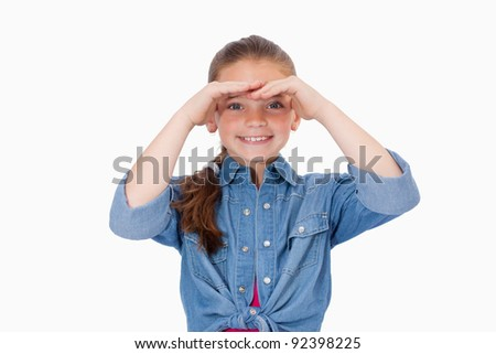Smiling girl looking ahead against a white background - stock photo