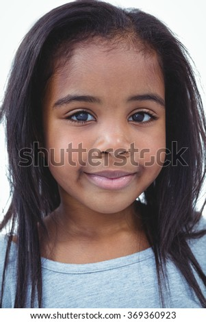 Smiling girl looking at the camera on white screen