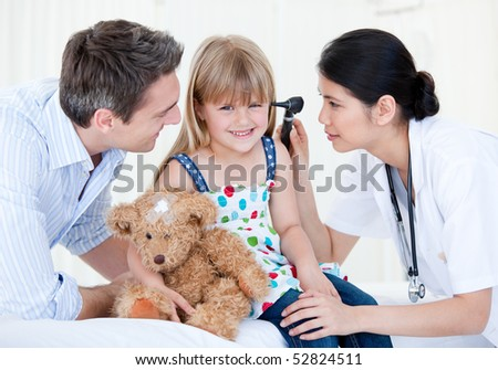 Smiling girl looks happy with her teddy bear against white background - stock photo