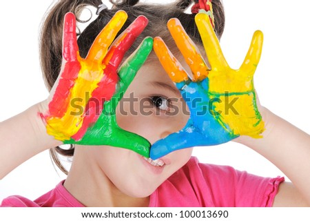 Smiling girl making triangle with her painted palms
