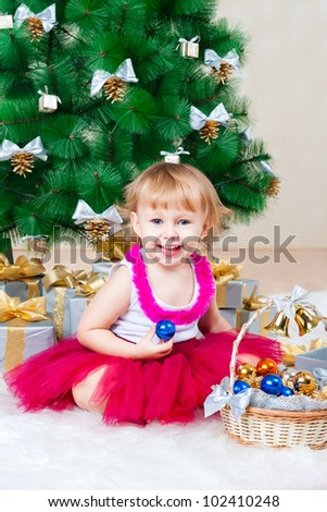 Smiling girl near a Christmas tree