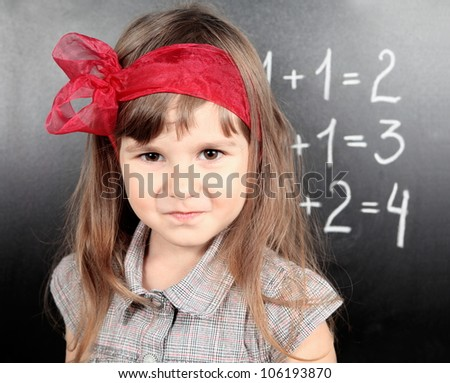 Smiling Girl Near Blackboard Proud of Performing the Task