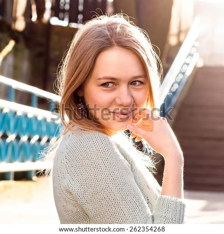 Smiling girl on evning sunshine - stock photo
