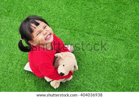 smiling girl on grass - stock photo